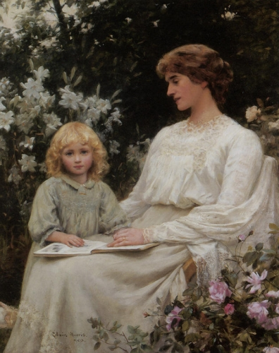 Portrait of a mother and daughter reading a book.jpg